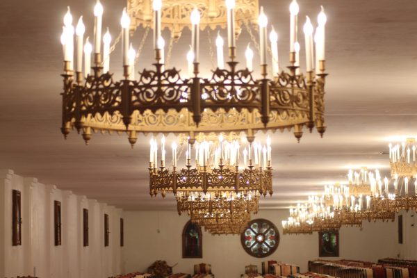 Golden Chandeliers shaped like crowns line the ceiling of the barrel room e