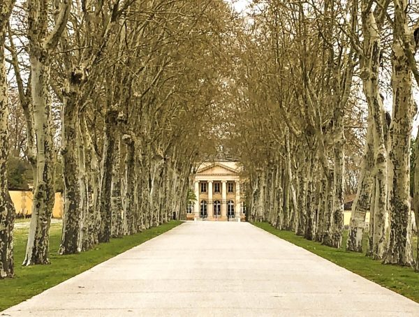 View of tree lined driveway and Chateau Margaux