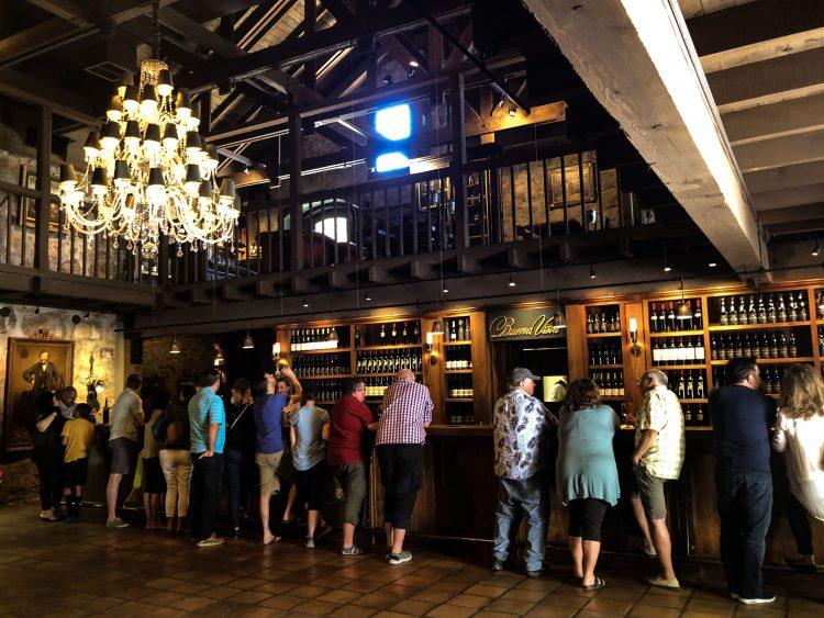 Interior shot of Buena Vista showcasing a packed tasting room under Chandelier
